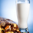 Fresh Glass of Milk and Closed Pack of muesli on a blue backgrou — Stock Photo