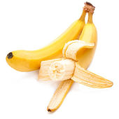 Bitten off yellow bananas ripe Isolated Located cascade on White — Stock Photo