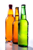 Beer in plastic bottle and Two glass bottles with beer, brown an — Stock Photo