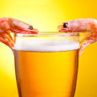 Two Cooked Shrimp in a glass of beer with foam on a yellow backg — Stock Photo