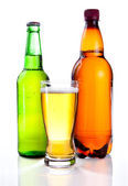Isolated Glass Beer in plastic bottle and glass green bottles wi — Stock Photo