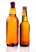 Isolated Brown plastic bottle and glass bottle of beer on a whit — Stock Photo
