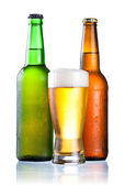 Brown and green bottles full of condensate and covered with a gl — Stock Photo