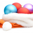 Christmas Red, Purple, Blue Baubles in Traditional Santa Hat Iso — Stock Photo