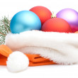 Christmas Red, Purple, Blue Baubles in Traditional Santa Hat and — Stock Photo