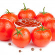 Bowl with fresh ketchup and six wet juicy ripe tomatoes isolated - Stock Photo