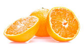One ripe juicy tangerine and two half isolated on white backgrou — Stock Photo