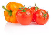 Wet Tomatoes and Yellow Bell Pepper with drops isolated on white — Stock Photo