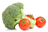 Broccoli and Three Tomato with drops Isolated on white backgroun — Stockfoto