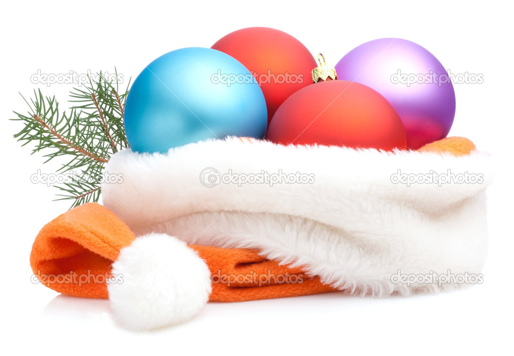 Christmas Red, Purple, Blue Baubles in Traditional Santa Hat and branch of tree Isolated on white background — Stock Photo #11567547