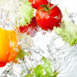 Three Fresh red Tomatoes, Yellow Bell Pepper and lettuce in spla — Stock Photo