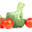 Fresh Broccoli and three red juicy tomato Isolated on white back — Stock Photo