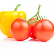 Sweet yellow bell pepper and Three Vine fresh juicy tomato Isola - Foto de Stock