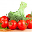 Stock Photo: Fresh wet tomatoes, brocolli and lettuce on cutting board wood