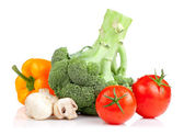 Set of vegetables: Broccoli, tomatoes, mushrooms and yellow pepp — Stock Photo