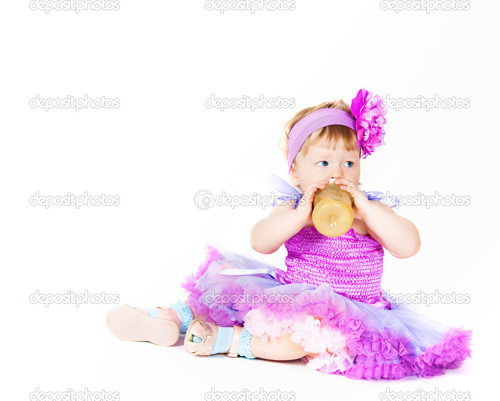 The small elegant girl with a children&#039;s small bottle  Stock Photo #11148611