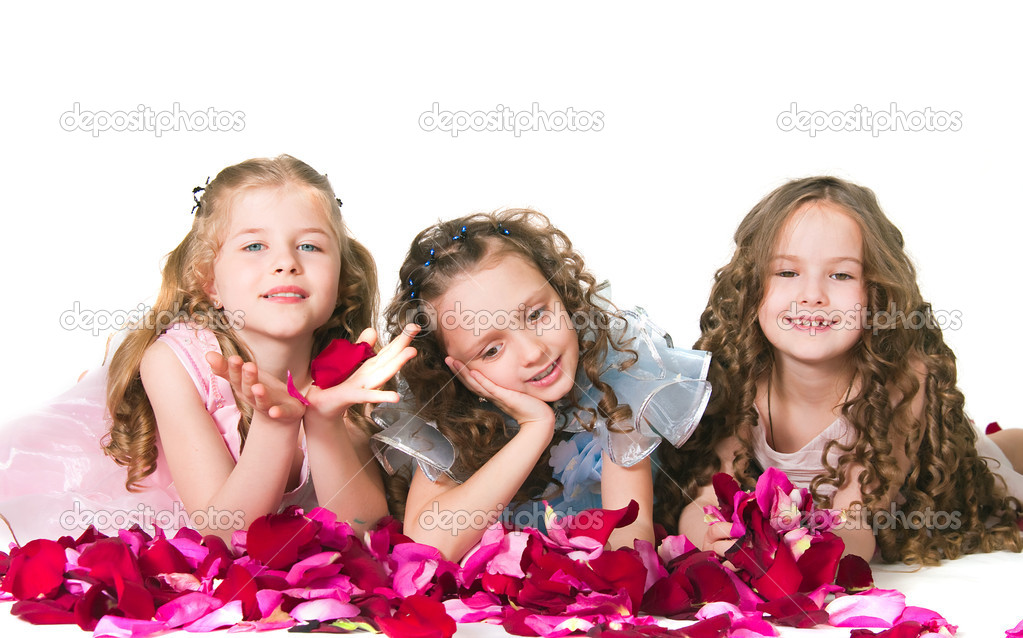 Three elegant girls on with rose-petals on a white background — Stock Photo #11200585