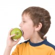 Young boy eating apple — Stock Photo #10958517