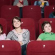 Mother and children in the movie — Stock Photo