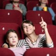 A girl with mother at the cinema — Stock fotografie