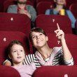 A girl with mother at the cinema — 图库照片