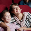 Mother with daughter in the movie — Stock Photo