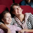 Mother with daughter in the movie — Stock Photo #10959630
