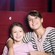 Mother and child at the cinema — Stock Photo