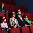 Young family in the movie theater — Stock Photo #10959639
