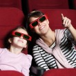 A girl with mother in 3D movie theater — Stock Photo