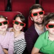 Stock Photo: Happy family in 3D movie theater