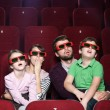 Surprised family in 3D movie theatre — Stock Photo
