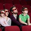Frightened family in 3D movie — Stock Photo