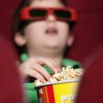 A boy eating popcorn — Stock Photo