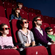 Parents with children at the cinema — Stock Photo