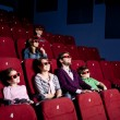 Parents with children watching a comedy — Stock fotografie