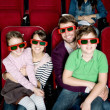 Happy family watching a movie — Stock Photo