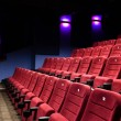 Red seats of cinema hall — Stock fotografie #10959776