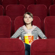 Young woman with a snack food — Stock Photo #10959838