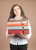 Yong businesswoman with folder — Stock Photo