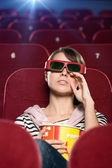 A crying woman in the movie theater — Stock Photo