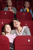 Young girl in the movie — Stock Photo