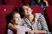 Mother with daughter in the movie — Stockfoto