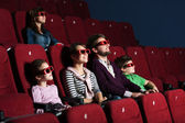 Young family in the movie theater — Stock Photo