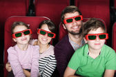 Happy family in 3D movie theater — Stock Photo