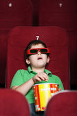 A boy at the cinema — Stock Photo