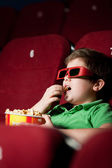 Frightened boy in 3D movie — Stock Photo