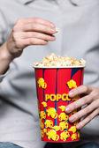 Enjoying popcorn — Stock Photo