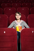 Young woman watching a movie — Stock Photo