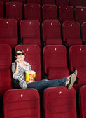 Young woman with popcorn in 3D movie — Stock Photo